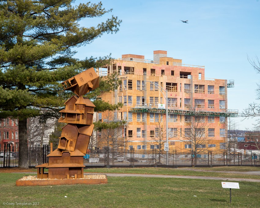 Portland, Maine USA April 2017 photo by Corey Templeton of American Dream sculpture by Judith Hoffman in Lincoln Park and Luminato Condos behind.