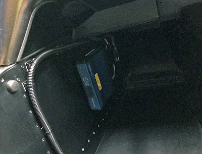 VBOX HD2 in Caterham passenger footwell with corrugated tubing keeping everything neat and tidy