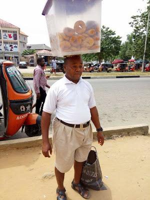 Inspiring Photos Of Neatly Dressed Man Spotted Hawking Doughnuts In Akwa Ibom