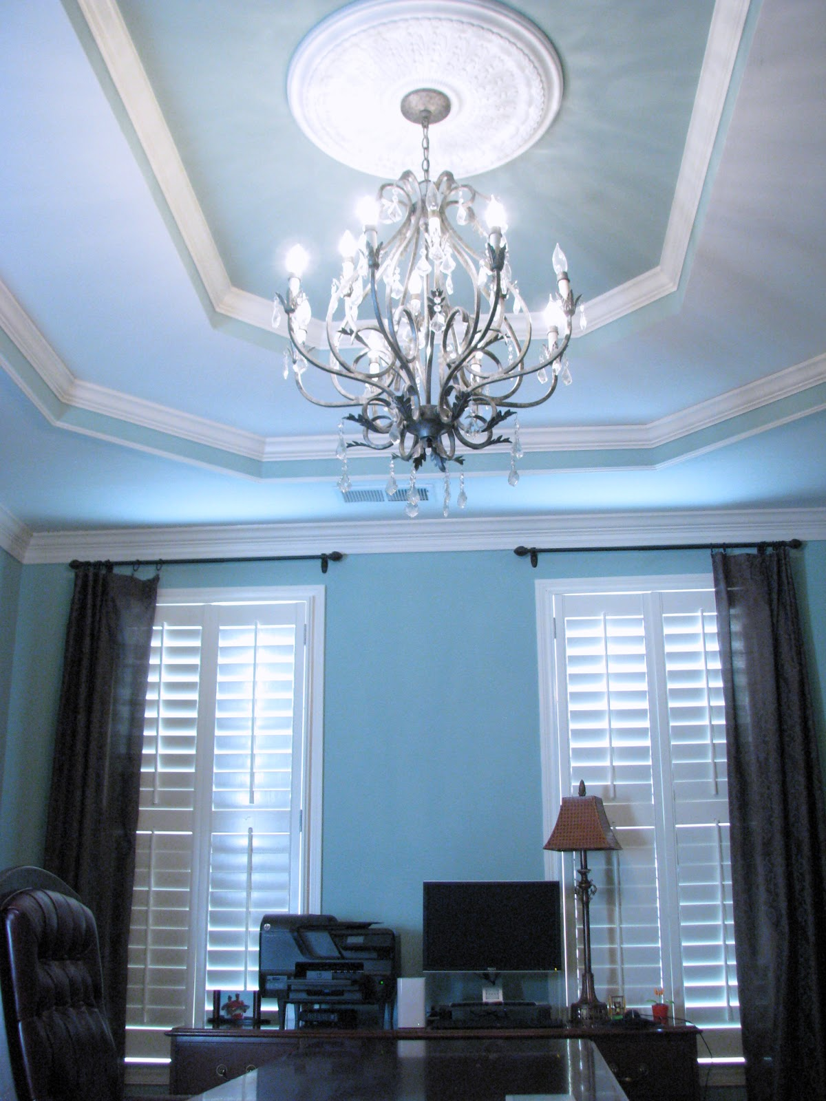 Office with chandelier, trey ceiling, and ceiling medallion