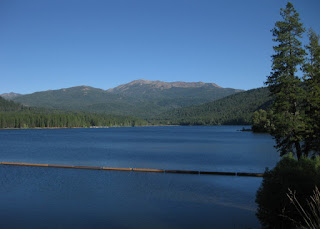 View of Lake Siskiyou with hills in the distance, Mt. Shasta, California
