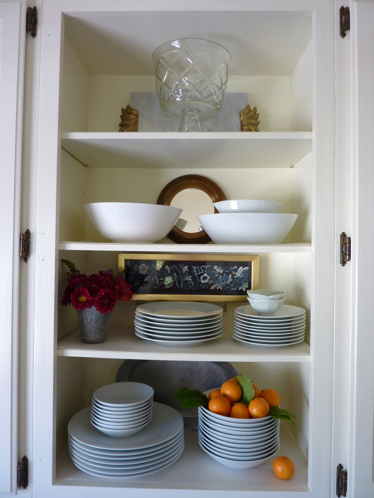left the door off one of the upper cupboards for an open shelf look