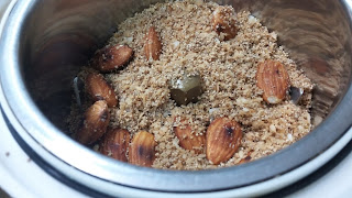 Roasted almonds with coconut powder