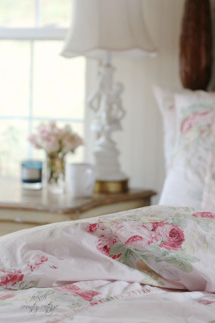 Blush pink bedding with pink flowers close up