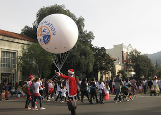 Los Gatos Recreation Department balloon with marchers, W. Main Street, Los Gatos, California