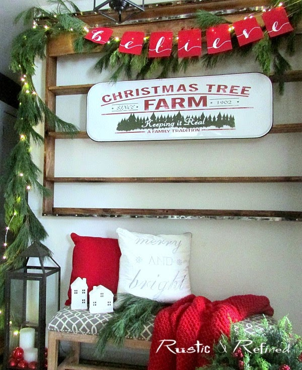 Entryway decorated for Christmas using fresh greenery, gorgeous color, thrift store items and decor from the target dollar spot.