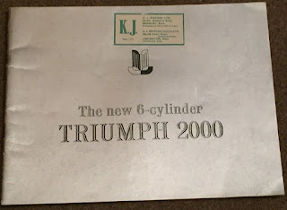 K J Motors Ltd dealer address sticker on a Triumph 2000 brochure
