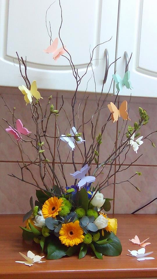 paper butterflies in flower arrangement