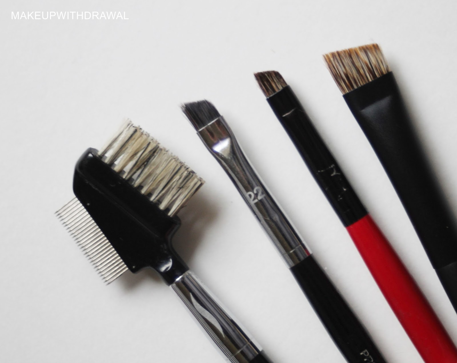 brow brush sephora. from left to right: sephora collection pro #15 brow comb, #22, smashbox angled brush #12, chikuhodo t-9