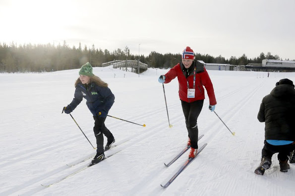Crown Princess Mette Marit and Crown Prince Haakon of Norway and Princess Ingrid Alexandra and Sverre Magnus skiing with young immigrants at Birkeneier stadion
