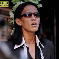 Lirik dan Terjemahan Lagu Thomas Arya - Rindu Takubua Dalam