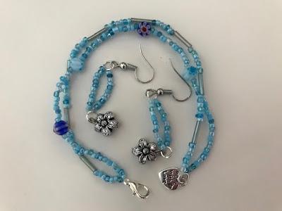 Homemade beaded bracelet and earrings