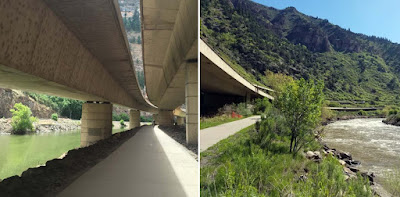 Bicycle trail running under highway by river