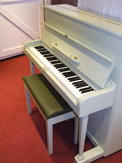 refurbished and painted pianos