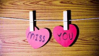 miss you notes in shape of pink paper hearts