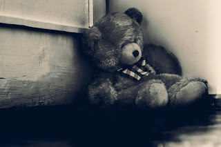 Teddy-bear-crying-sitting-in-corner-of-room-photo-image.jpg