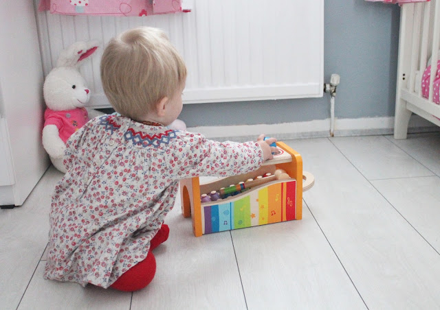 child playing with  Pound N Tap Bench With Xylophone