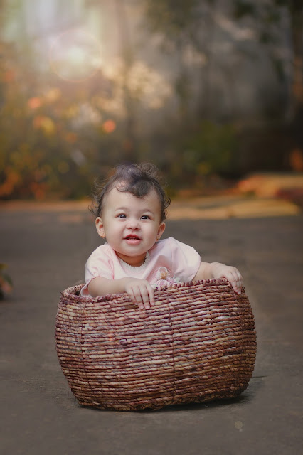 Mamatha photography captures the baby in a beautiful basket