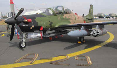 Image result for super Tucano A-29 ground attack aircraft and weapons
