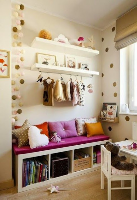 Ikea hack for Kallax shelving to make chic window seat in kids room - found on Hello Lovely Studio