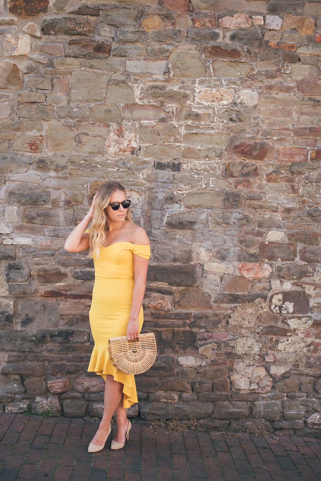 Rachel Emily in Yellow John Zack dress by Stone Wall with Sunglasses and Structured Bamboo Bag