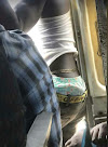 Bus Conductor Spotted Putting On Waist Beads In Lagos
