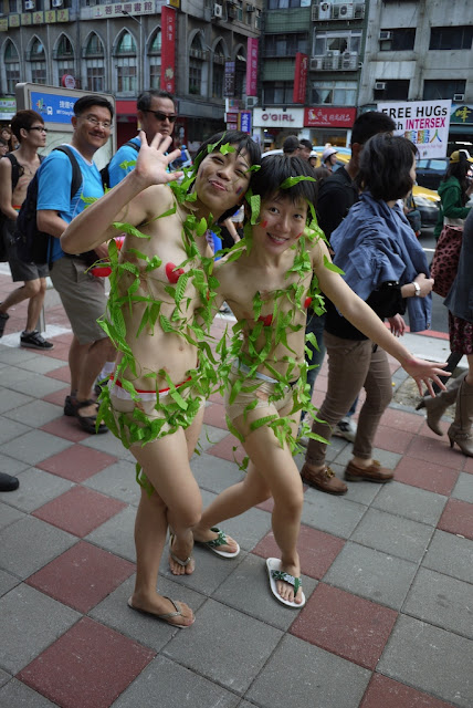 same two young women who are dressed with minimal covering and vines at 2011 Taiwan LGBT Pride Parade