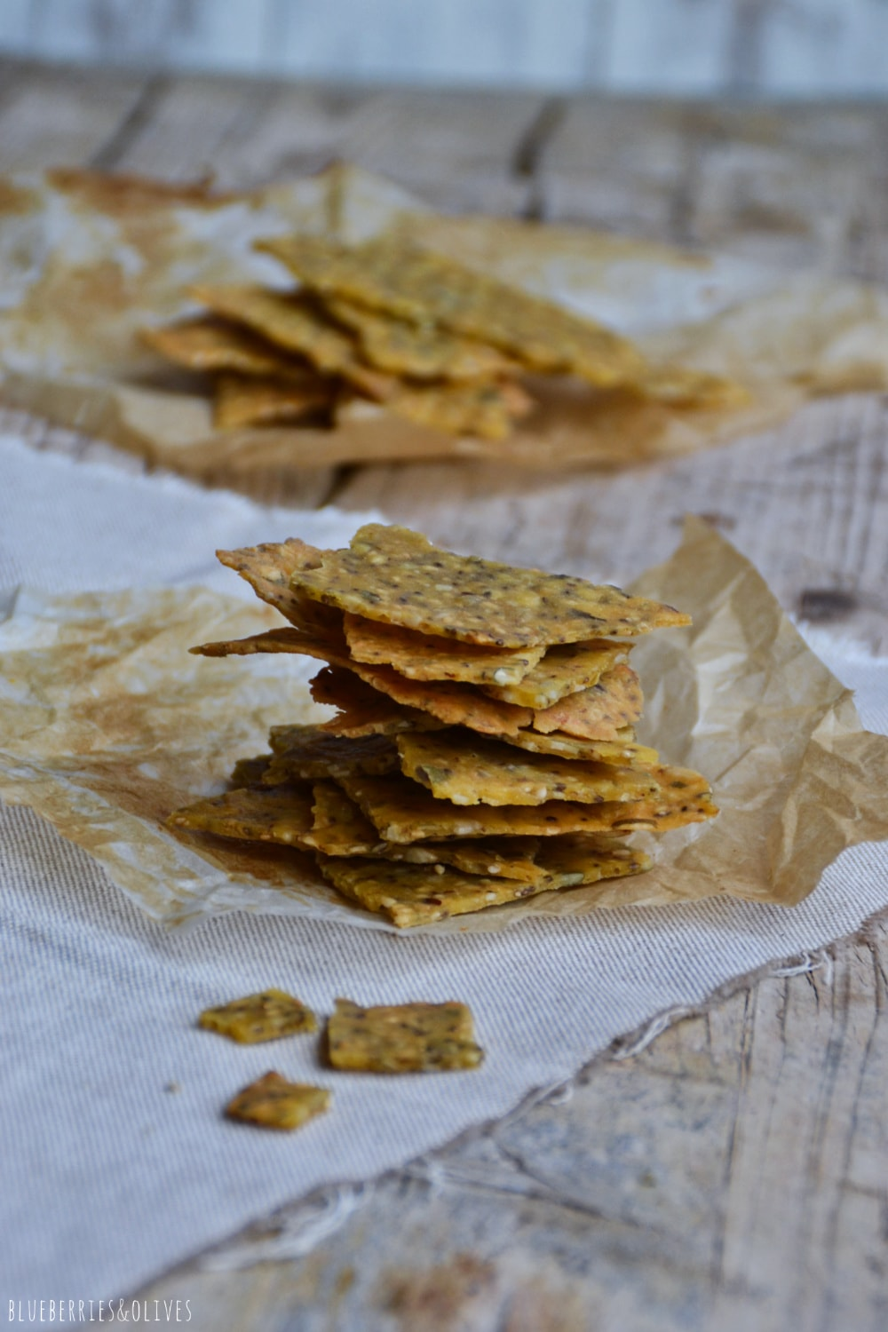 PILED CORN CRACKERS WITH AN OLD WOOD BACKGROUND