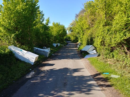 Photograph of 13 fridge freezers dumped at the western end of Bradmore Lane. Image by North Mymms News released under Creative Commons BY-NC-SA 4.0