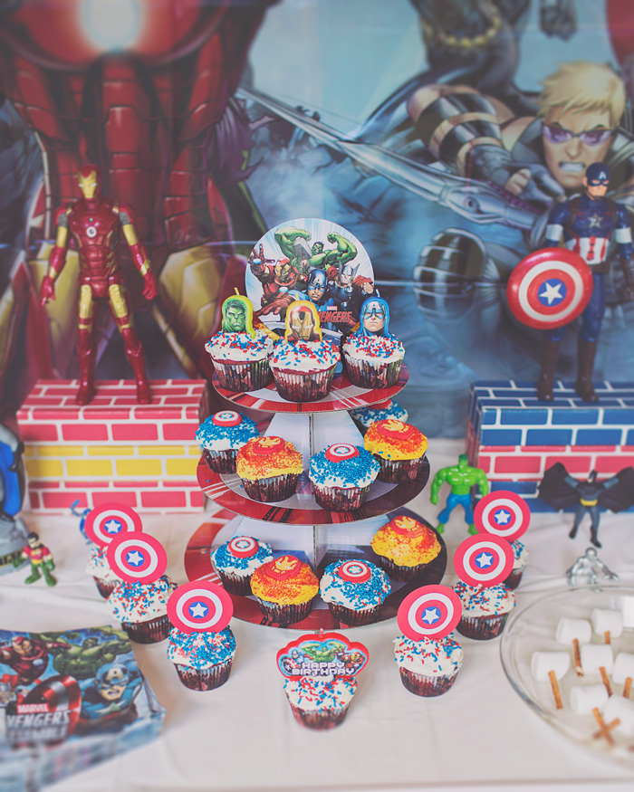 Avengers birthday party cupcakes on cardboard shield stand