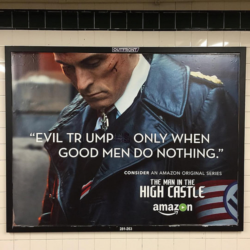 Trump Nazi Graffiti on a subway poster. Man in the High Castle Long Island City, Court Square station. 'Evil Trump Only When Good Men Do Nothing' Lost your confederate flag? marchmatron.com