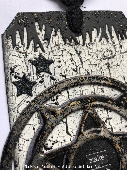 Embossed Stardust die on crackled black and white tag