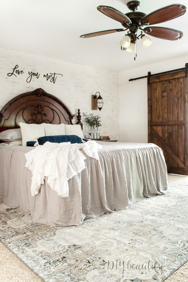 ruffled bedspread and plush pillows