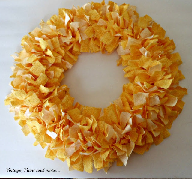 DIY Spring wreath made from fabric strips tied to a wreath form