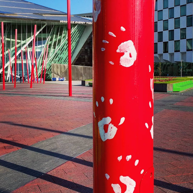 Dublin city walks: Grand Canal Dock in the Dublin Docklands. Handprints on a red pole outside the Bord Gais Theatre