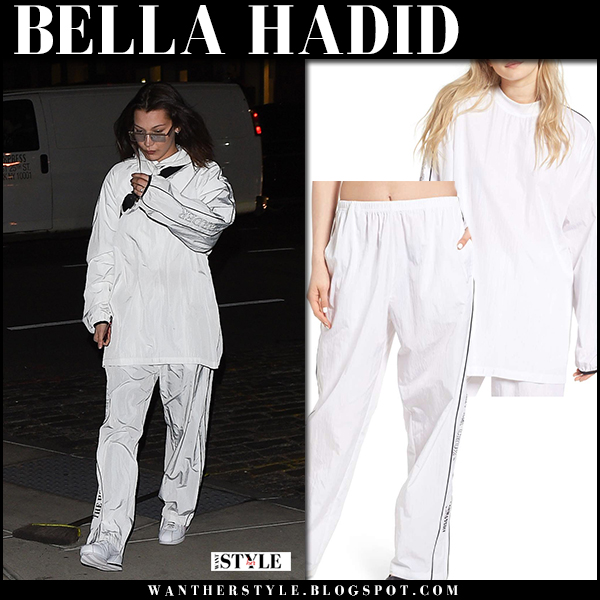 Bella Hadid in white tracksuit hyein seo and sneakers street style february 6