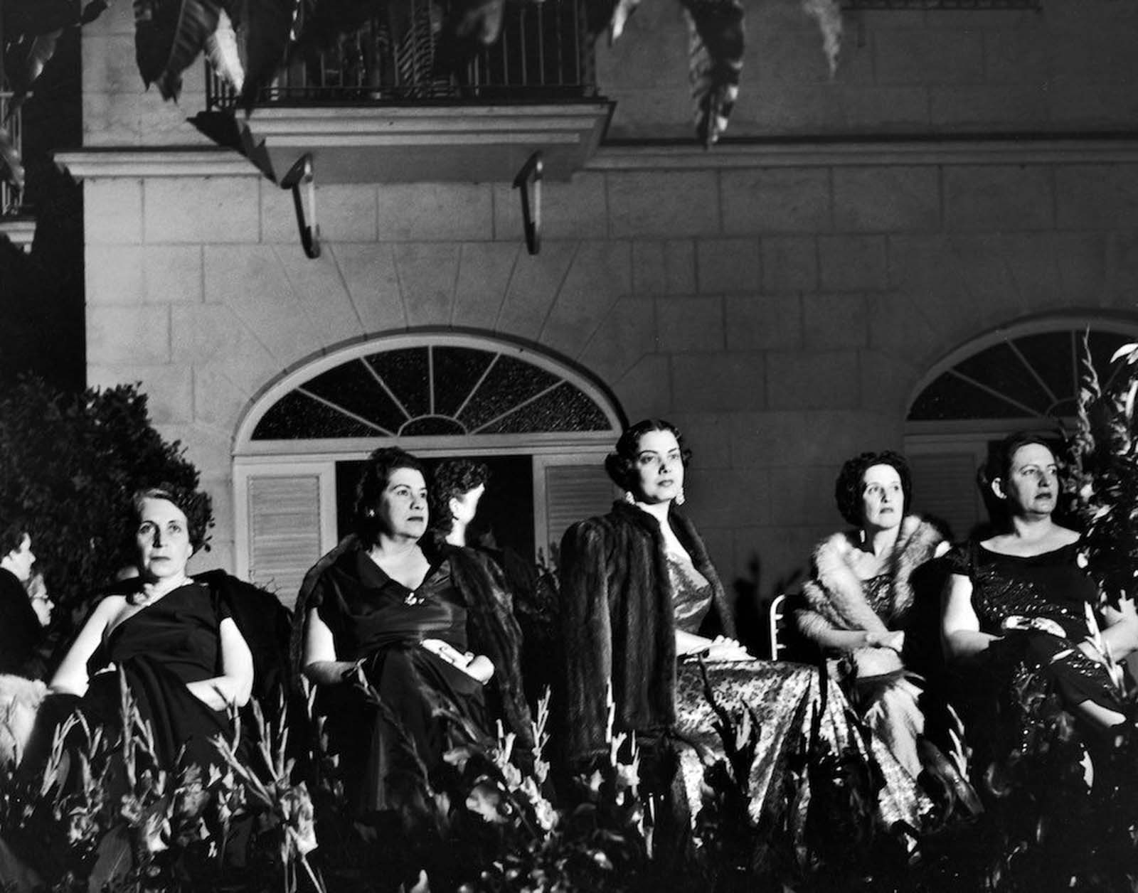 A party in Havana where the mothers chaperone their unmarried daughters.  c. 1950.