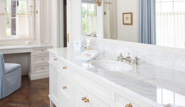 Premier Surfaces White marble topped vanity in the Bathroom