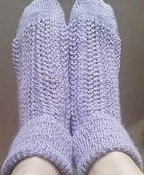 http://www.ravelry.com/patterns/library/stellas-lacy-bobbie-socks