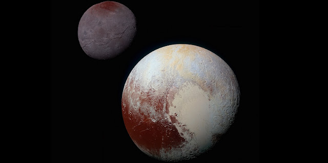 "Pluto, shown here in the front of this false-color image, has a bright ice-covered ""heart."" The left, roughly oval lobe is the basin provisionally named Sputnik Planitia. Sputnik Planitia appears directly opposite Pluto's moon, Charon (back). Credit: NASA/JHUAPL/SWRI."