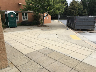 Sidewalk to the side of front entrance of library