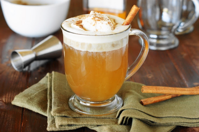Hot Buttered Rum Topped with Whipped Cream photo