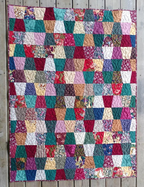 Tumbler quilt made with ugly fabrics