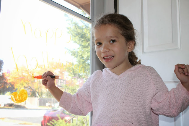 Girl coloring with liquid chalkers markers