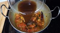 Adding-tamarind-extract-fro-rasam