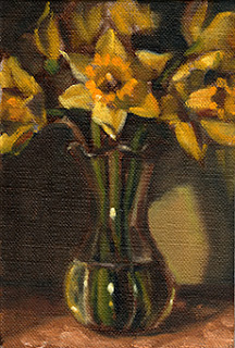 Oil painting of a bunch of yellow daffodils in a tulip-shaped vase.