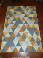 https://kristaquilts.blogspot.com/2018/07/triangles.html