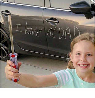 kid scratches car door with screwdriver