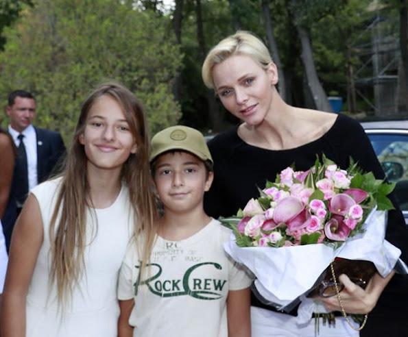 Prince Albert and Princess Charlene visited Monte Carlo Polo Clup, Princess Charlene style LOUIS VUITTON bag