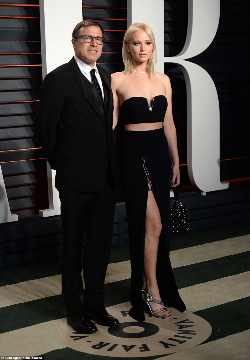 Jennifer Lawrence shows abs at the Vanity Fair Oscars Party
